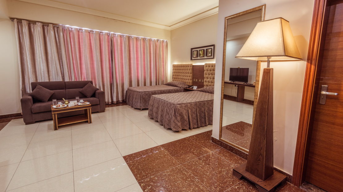 City View Twin bedroom with room service